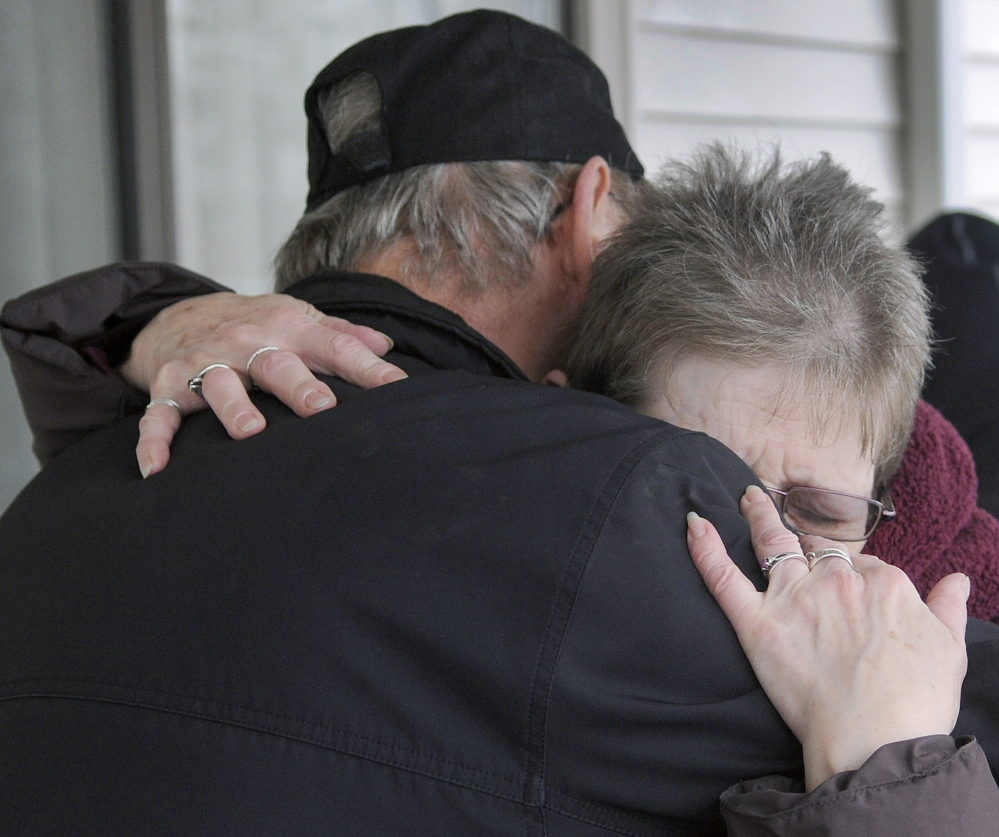 Alice Ingalls hugs Richard Reed on Wednesday after he gave her a donation at a motel in Augusta where she has been staying since losing her apartment to a fire last week. Ingalls said she shops at the Augusta Farmers Market, where Reed, of Readfield, maintains a booth.