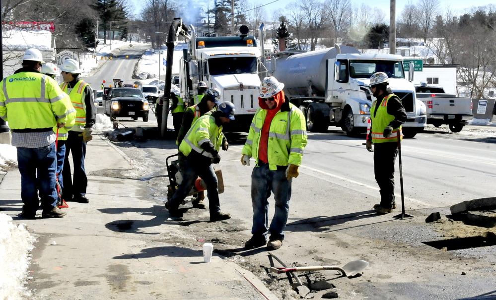 Employees of Summit Natural Gas of Maine and sub-contractors work on the gas pipeline in the center of Norridgewock in March. Safety violations by contractors of the company have led to fines.