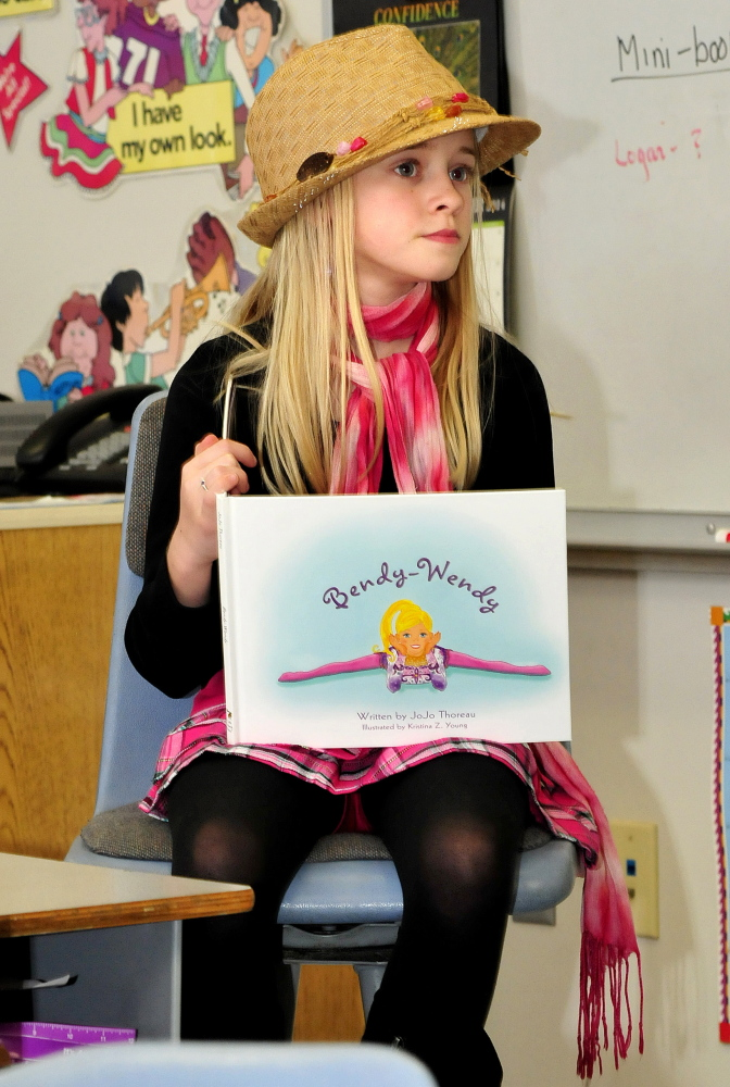 """Lydia Schofield, 9, of Thorndike, meets with fifth-graders at Cascade Brook School in Farmington to talk about her new book, """"Bendy Wendy,"""" which started when she and her mother would play a car game involving rhyming words."""