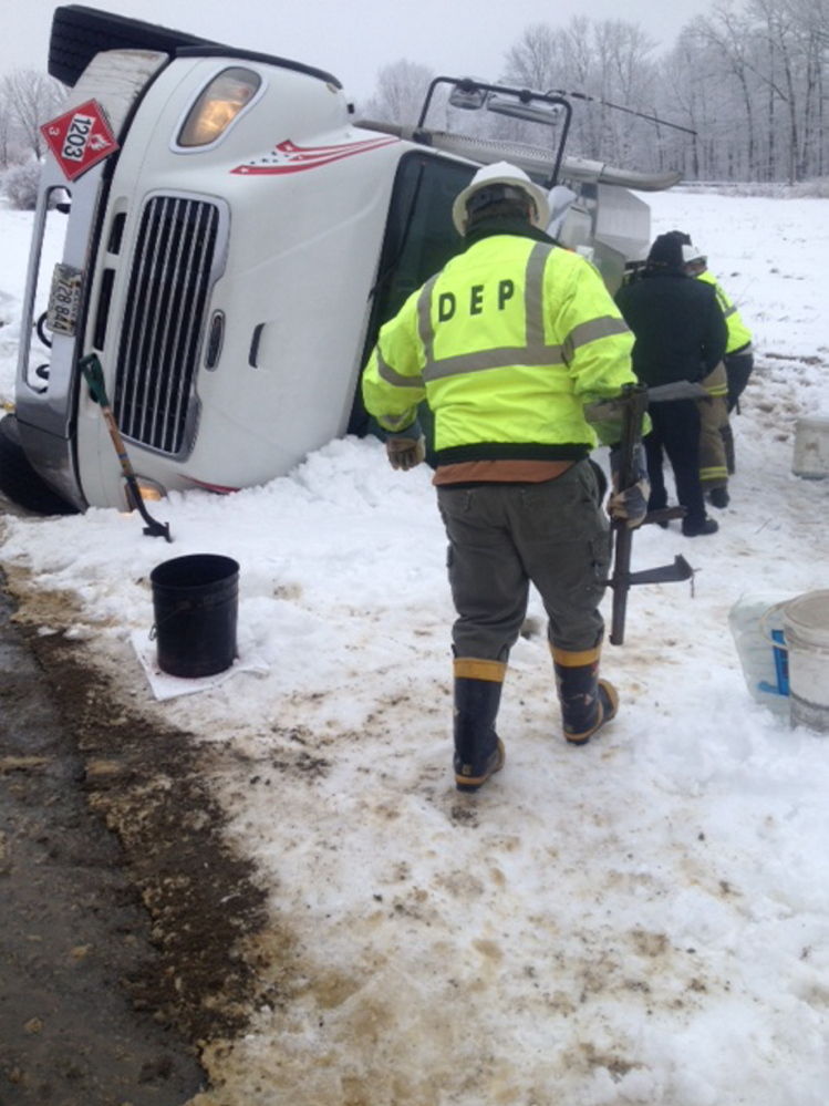 State Department of Environmental Protection crews responded to the scene of an oil spill on Bigelow Hill Road in Skowhegan on Friday morning after an oil delivery truck flipped over.