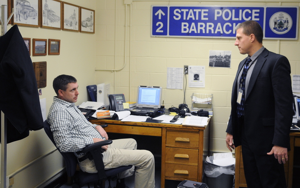 Maine State Police Sgt. Jeff Love, right, the lead detective in the Ayla Reynolds case, confers with Troop D Detective Adam McNaughton at the state police barracks in Augusta last week.