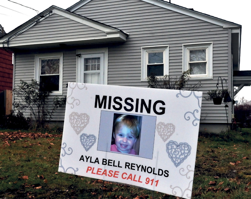 STILL MISSING: A sign and photograph of Ayla Reynolds has been placed in front of 29 Violette Ave. in Waterville where she was reported missing nearly a year ago.