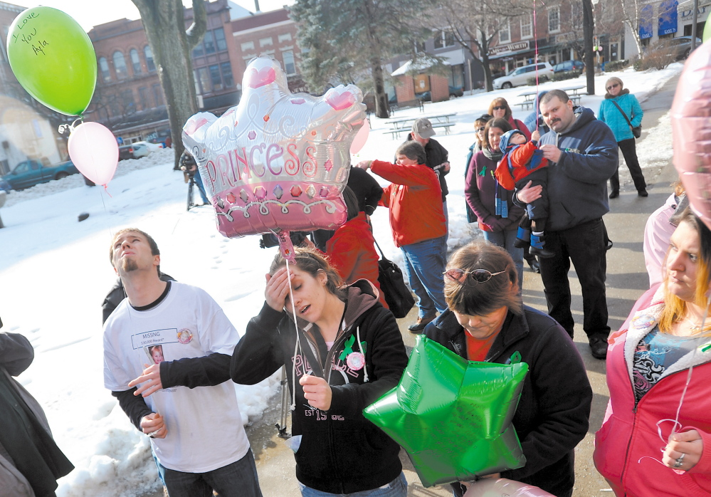 Justin DePietro, far left, Trista Reynolds, center left, parents of missing toddler Ayla Reynolds, release balloons during a vigil in Castonguay Square in Waterville in January 2012. Becca Hanson, right center, mother of Trista Reynolds, and Amanda Benner, far right, friend of Trista Reynolds, also are seen.