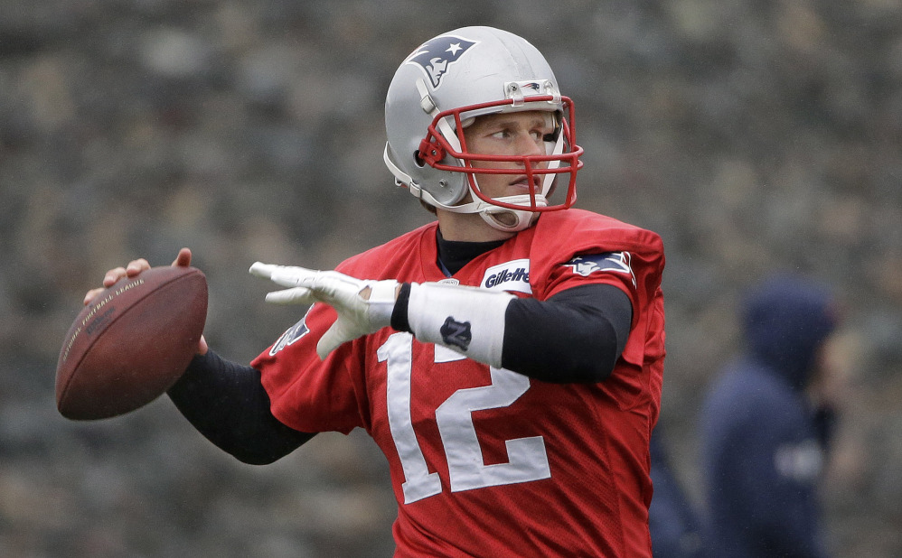 New England Patriots quarterback Tom Brady throws a pass during practice at the team's facility in Foxborough, Mass. The Patriots will play the Miami Dolphins Sunday in Foxborough with a chance for the Patriots to clinch the AFC East and a playoff spot.