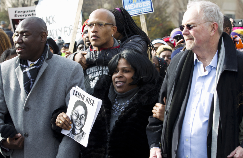 Samaria Rice center, the mother of Tamir Rice, the 12-year old boy who was fatally shot by police officer in Cleveland, and others, march in Pennsylvania Avenue toward Capitol Hill in Washington, Saturday, during the Justice for All rally.