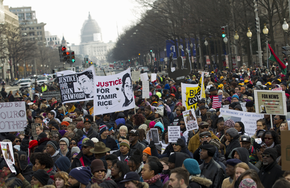 Demonstrators chant at Freedom Plaza in Washington, Saturday during the Justice for All rally. More than 10,000 protesters are converging on Washington in an effort to bring attention to the deaths of unarmed black men at the hands of police.