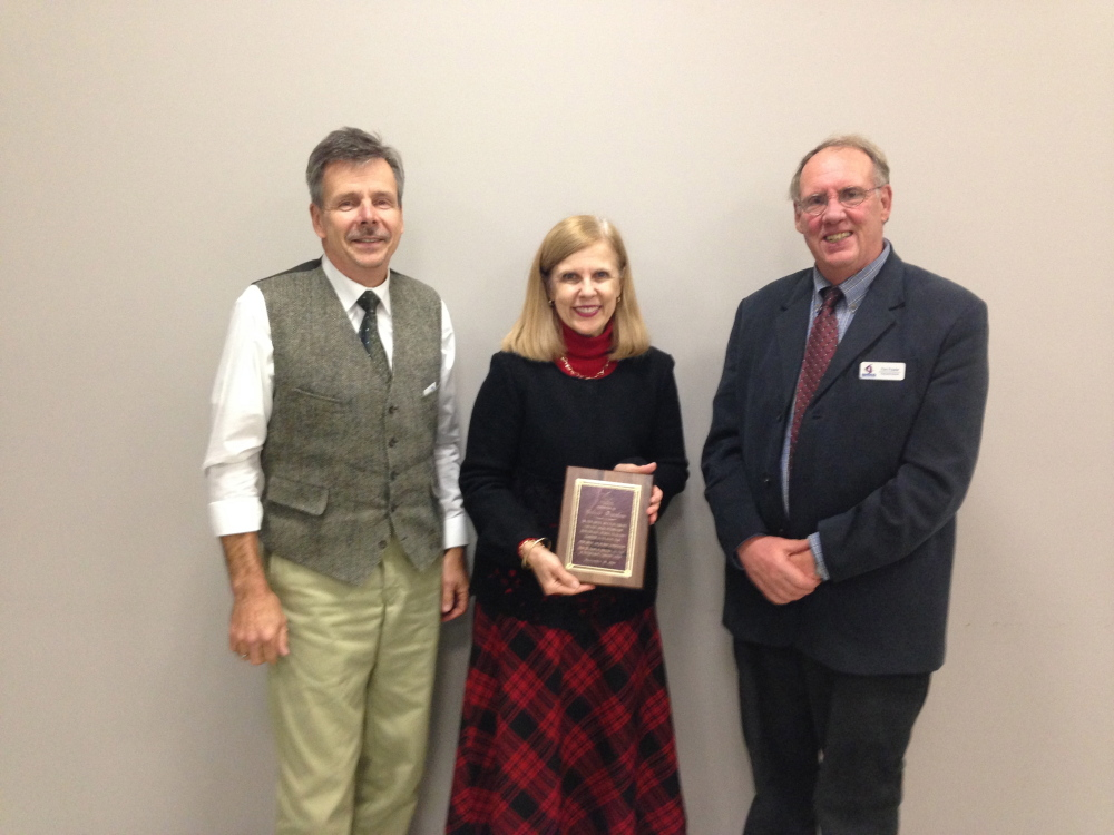 Contributed photo Western Maine Community Action honors outgoing Board President F. Celeste Branham. From left are Norm Croteau, F. Celeste Branham and Fenwick L. Fowler.
