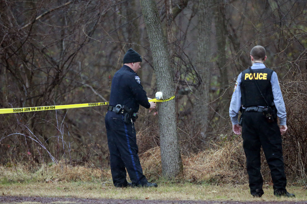 Police cordon off a wooded area during the search for suspect Bradley William Stone, Tuesday, in Pennsburg, Pa.