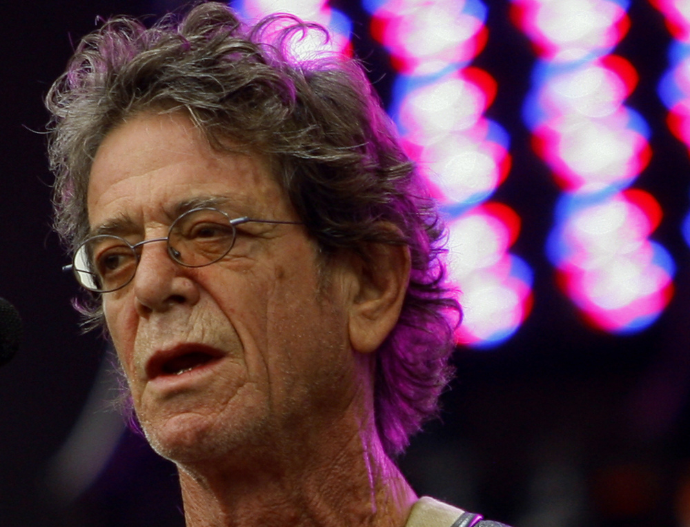 In this Sunday, Aug. 9, 2009, file photo, Lou Reed performs at the Lollapalooza music festival, in Chicago.