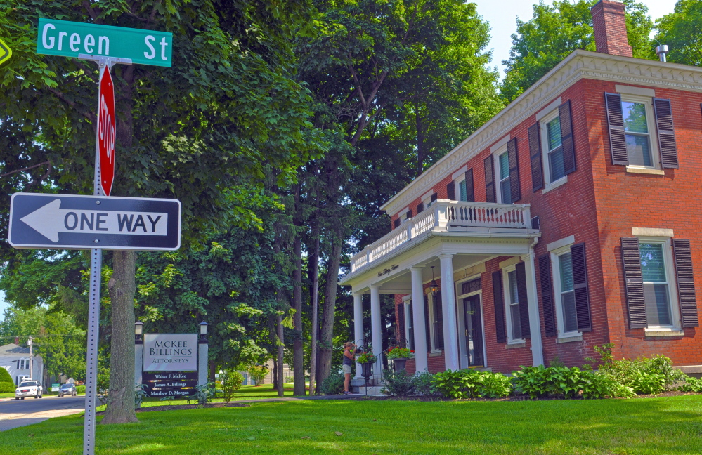 The traffic signs at the corner of Green and State streets in front the McKee Billings law offices, seen in a photo taken on July 25. City officials are debating whether to change the one-way portion of the street to two-way traffic.