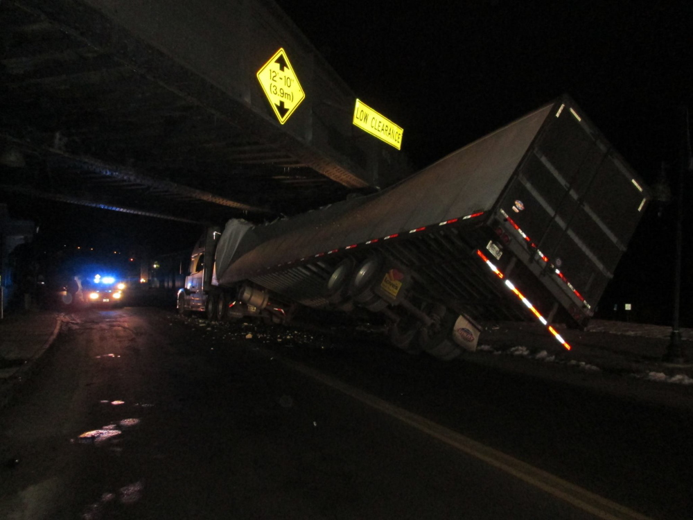 A tractor-trailer got stuck under the railroad bridge on Water Street in Augusta around 11:30 p.m. Monday. The driver wasn't injured, but the trailer was damaged extensively, police said.