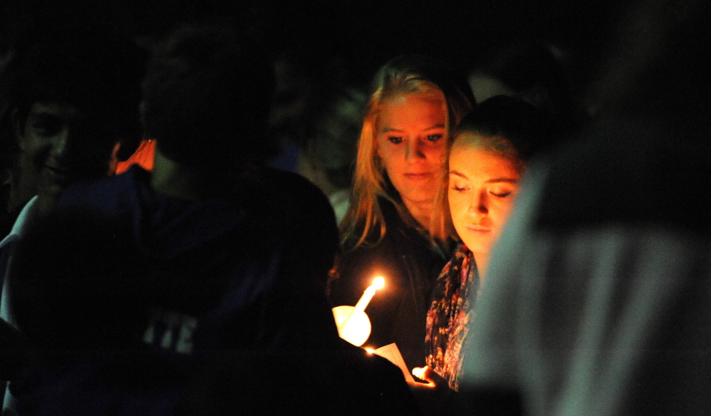 Friends and family of Cassidy Charette gather on Oct. 14 for a candlelight vigil at Mount Merici School in Waterville.