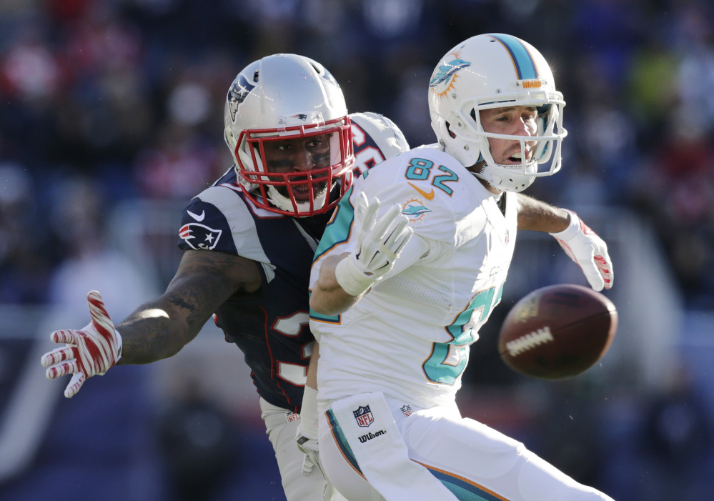 Miami Dolphins wide receiver Brian Hartline (82) can't catch a pass in front of New England Patriots cornerback Brandon Browner, rear, in the first half last week in Foxborough, Mass. The Patriots won 41-13. New England plays the New York Jets on Sunday.