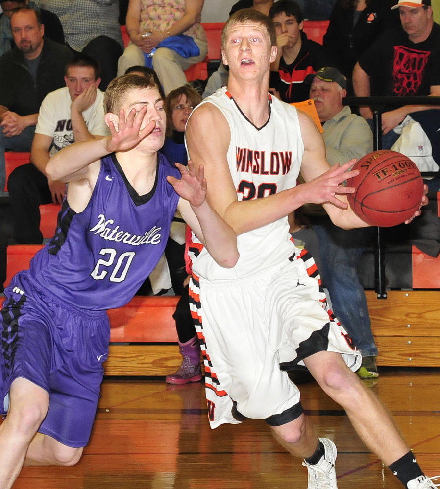 Winslow's Justin Martin drives with the ball against Waterville's Adam Barre at Winslow on Tuesday.