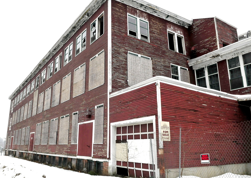 The closed and boarded-up Forster Mill building is part of a district proposed to be declared a slum and blight area, making the town eligible for federal assistance.