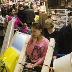 People wait in a line to pay for her purchases at the IKEA store on the outskirts of Moscow, Russia, Wednesday.