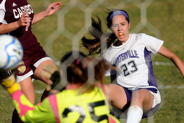 Waterville striker Pilar Elias, 23, scores against Caribou High School during an Eastern B semifinal game this fall. The Maine Soccer Coaches named Elias an All-American.