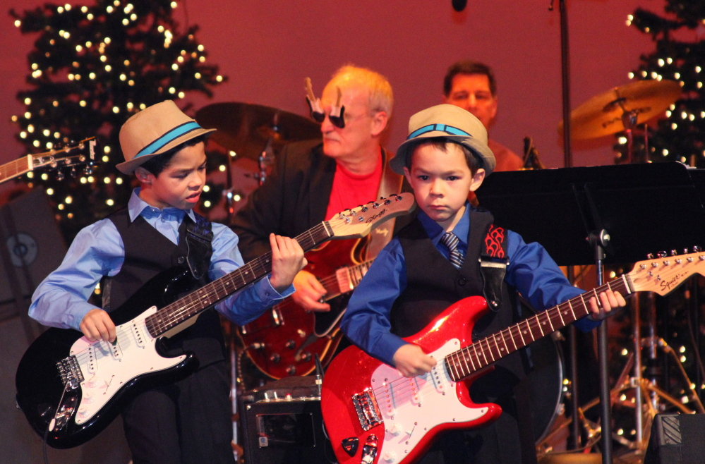 Cameron Mushero, 8, left, and Connor Mushero, 5, of Oakland performed recently at the Warming Up for Christmas Show, an annual benefit concert put on by Steve Fotter and students, at Williamson Center at Lawrence High School in Fairfield. Seventy students performed, 700 people attended and more than $13,000 was raised for First Choice Pregnancy Resource Center.