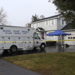 A State Police van on the scene of a home invasion and double shooting in Saco Thursday.