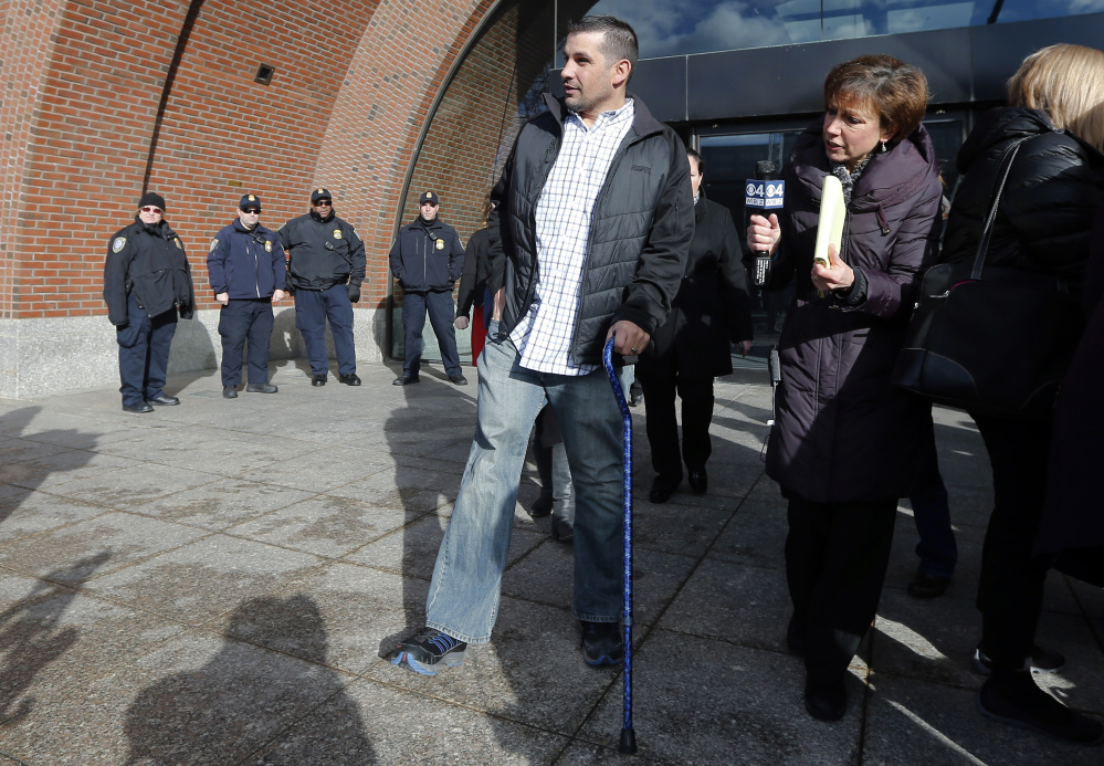 Boston Marathon bombing victim Marc Fucarile leaves federal court in Boston, Thursday, Dec. 18, 2014, after a hearing for bombing suspect Dzhokhar Tsarnaev, whose trial begins in January. Tsarnaev is charged with carrying out the April 2013 attack that killed three people and injured more than 260.