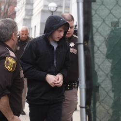 Justin Woodbury, the juvenile accused of making email threats against RSU 14, arrives for his initial court appearance in Portland.