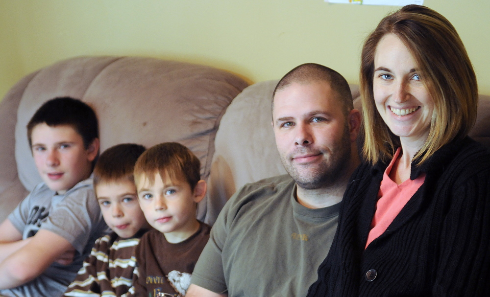 Cyndi MacMaster with her husband, Scott, and her sons Tripp, 5, center, Parker, 7, and Jake, 12, at their Dresden home on Dec. 7.
