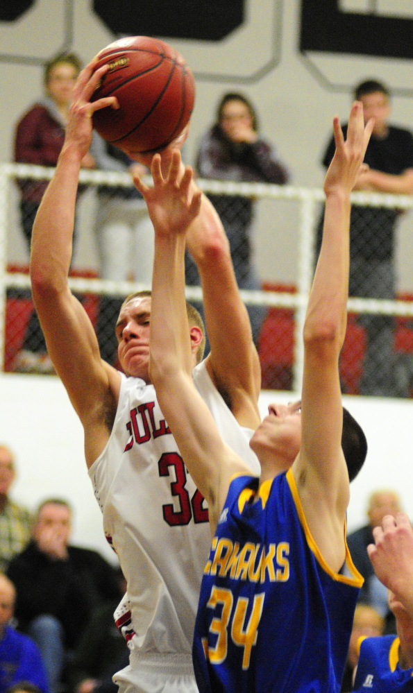 Hall-Dale's Wesley LaPointe grabs a rebound in front of Boothbay's Nick Burge during a Western C game Friday at Hall-Dale High School in Farmingdale.