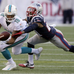 Miami Dolphins wide receiver Rishard Matthews (18) catches a pass as New England Patriots defensive back Malcolm Butler (21) defends in the first half last week in Foxborough, Mass. The Patriots play the New York Jets on Sunday in East Rutherford, N.J.
