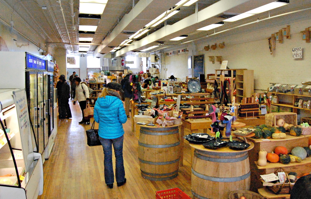 Shoppers peruse the wares of Barrels Community Market on Saturday in Waterville. Founded as a nonprofit by Waterville Main Street, the market sells Maine crafts and food.