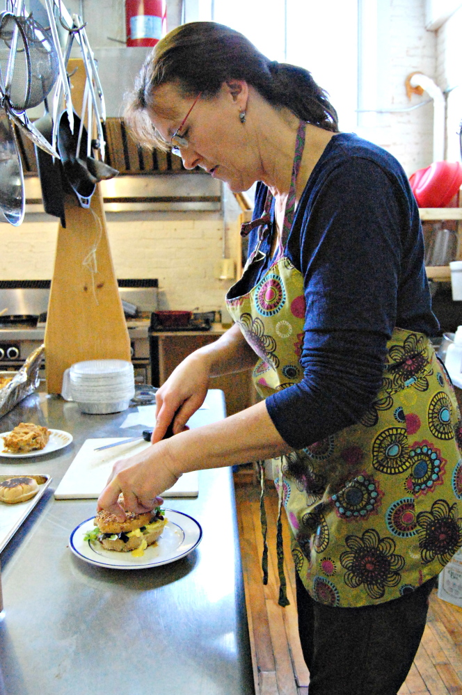 Barrels Community Market assistant manager Jean Rosborough prepares Saturday brunch. The craft-and-food cooperative on Main Street in Waterville plans to begin offering Sunday brunch after Jan. 1.