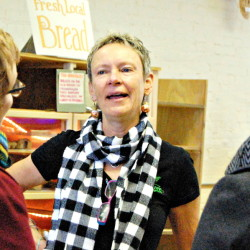 Waterville Mayor Karen Heck greets shoppers Saturday morning at Barrels Community Market on Main Street in Waterville.