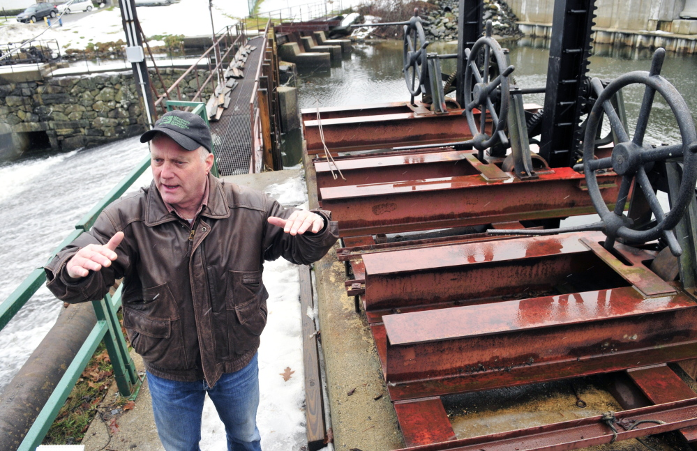 Jack Daniel, chairman of the New Mills Dam committee, leads a tour at the New Mills Dam on Thursday in Gardiner. The committee recently had new deep-water gates and posts replaced.