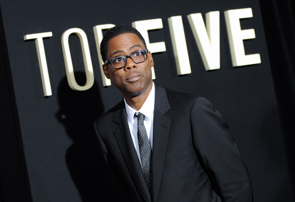 """In this Dec. 3, 2014 file photo, actor Chris Rock attends the premiere of """"Top Five"""" at the Ziegfeld Theatre in New York."""