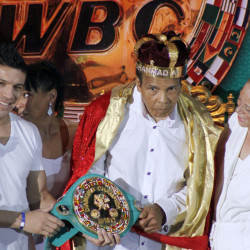 "In this Monday, Dec. 3, 2012, file photo, the former heavyweight boxing champion Muhammad Ali, center, is crowned ""King of Boxing"" while accompanied by his wife, Lonnie, right, and Argentine boxer Sergio Martinez during the 50th convention of the World Boxing Council in Cancun, Mexico."