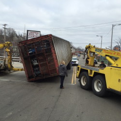 Bridge Street in Gardiner is blocked as crews work to remove a tractor-trailer that decoupled near the intersection of Water Street.