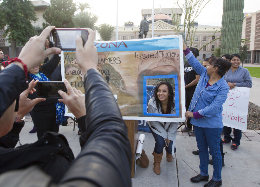Erika Andiola gets her portrait taken at the Arizona State Capitol on Dec 17, 2014, in Phoenix, Ariz.