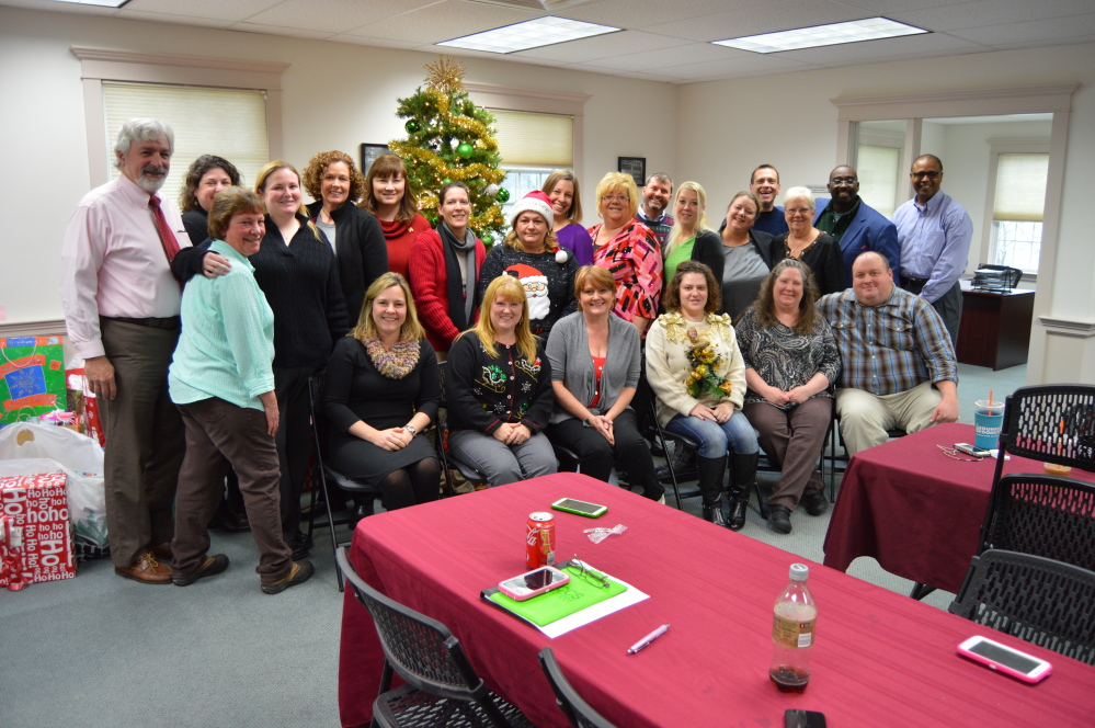 CCS personnel at the Dec. 18 Christmas party, CCS regional office in Augusta.