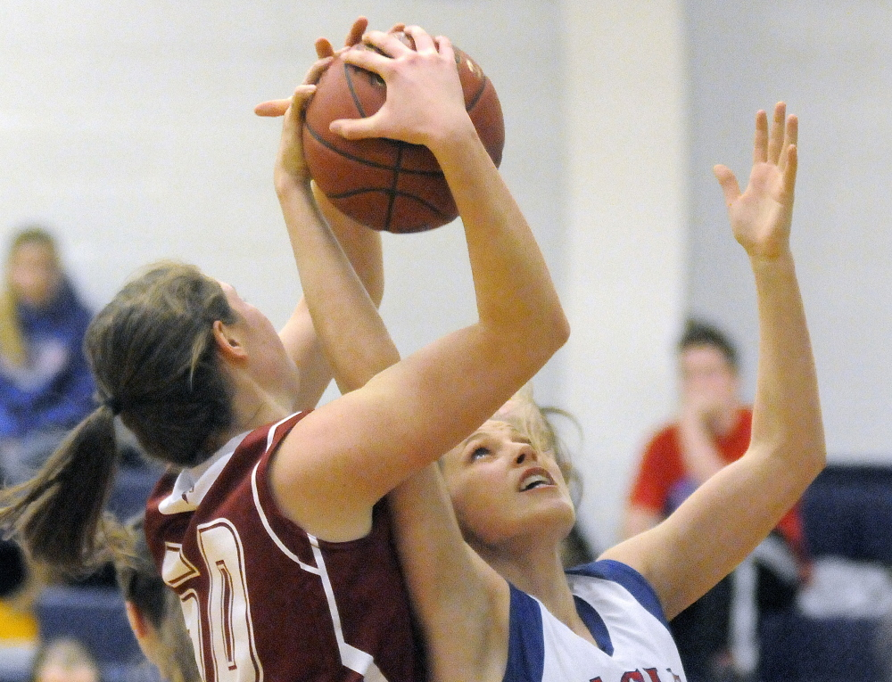 Messalonskee High School's Sophia Holmes, right, strips Bangor High School's Emily Gilmore of the ball during a game Tuesday in Oakland.