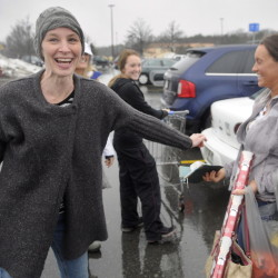Karyn Sweeney, left, laughs after handing Sierra Warner, of Monmouth, a gift Wednesday in the parking lot of Walmart in Augusta.