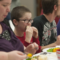 Donald Riopelle, center, and his mother Mary, left, both of Waterville, enjoy a Christmas day meal at Central Maine Family Christmas Dinner held at the Elks Club in Waterville on Thursday.Kevin Bennett Photo