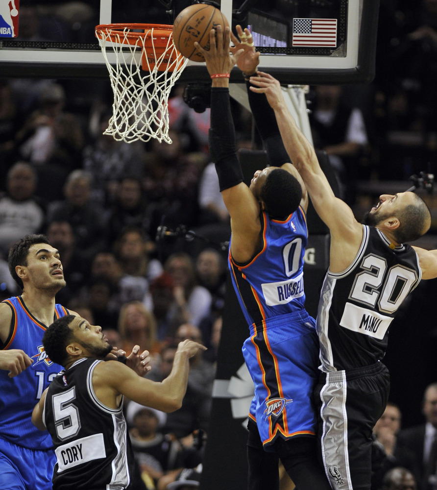 Oklahoma City Thunder guard Russell Westbrook (0) shoots against San Antonio Spurs guard Manu Ginobili (20) as Spurs' Cory Joseph and Thunder's Steven Adams, left, look on, in the first half Thursday in San Antonio. Oklahoma City won 114-106.