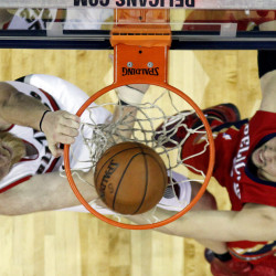 Portland Trail Blazers center Chris Kaman (35) dunks over New Orleans Pelicans guard Austin Rivers (25) during the second half last week in New Orleans. The Trail Blazers discovered a rattlesnake in its locker room recently while playing the San Antonio Spurs.