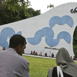 Acehnese pray for the victims of the Indian Ocean tsunami during its 10th anniversary at a mass grave in Aceh Besar, Aceh province, Indonesia, Friday. The devastating 2004 tsunami struck a dozen countries around the Indian Ocean rim, killing 230,000 people, most of them in Aceh.