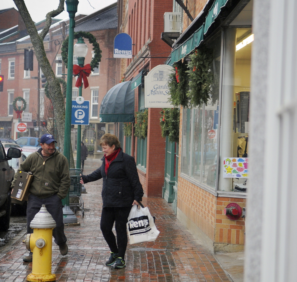 Shoppers exit Reny's in downtown Gardiner on Wednesday, a week after city councilors voted not to fill the director of economic and community development position that has helped attract businesses to the city.