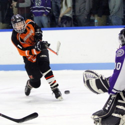 Winslow High School forward Jacob Trask fires a shot on Waterville High School goalie Nathan Pinnette during first-period action on Friday in Waterville. Winslow won the game 4-3.