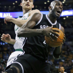 Brooklyn's Kevin Garnett, right, grabs a rebound in front of Boston's Tyler Zeller during the first quarter Friday in Boston.