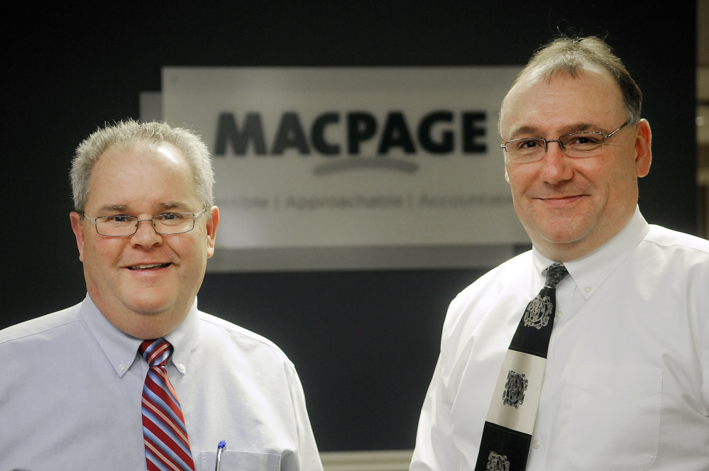 Macpage partners Scott Small, left, and Jeff Hubert at their Augusta office earlier this month. The firm is being recognized as Business of the Year by the Kennebec Valley Chamber of Commerce.