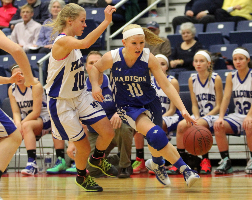 Madison Area Memorial High School's Madeline Wood tries to dribble past Mountain Valley High School's Emily Laubauskas during the first half of Saturday's opening game at the annual Capital City Hoop Classic at the Augusta Civic Center. Madison lost the game 60-29.