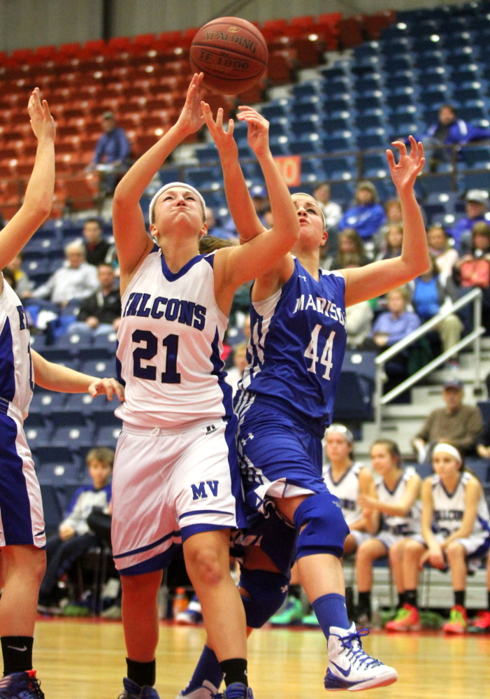 Madison Area Memorial High School's Erin Whalen fights for a rebound with Mountain Valley High School's Liza White during the first half of Saturday's opening game at the annual Capital City Hoop Classic at the Augusta Civic Center. Madison lost 60-29.