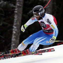 Travis Ganong speeds down the course on his way to win an Alpine ski, men's World Cup downhill, in Santa Caterina Valfurva, Italy, on Sunday.